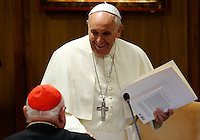 Papa Francesco saluta alcuni cardinali prima dell'inizio della sessione quotidiana del Sinodo sulla Famiglia, in Vaticano, 7 ottobre 2014.<br /> Pope Francis greets some cardinals as he arrives for the daily session of the synod on family issues, at the Vatican, 7 October 2014. <br /> UPDATE IMAGES PRESS/Riccardo De Luca<br /> <br /> STRICTLY ONLY FOR EDITORIAL USE