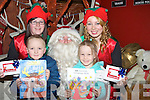 COLOURING:Luke Kerins and Ava Gannon from Tralee who were the lucky winners out of hundreds who entered the CH Chemist Christmas Colouring Competition and were ptrese4nted with their prizes by Santa in his Grotto in CH Chemist Tralee. L-r: Irene Lynch(elf Santa helper), Luke Kerins(winner), Santa, Ava Gannon (2nd) and Ciara Rogers (elf Santa helper)..... . ............................... ..........
