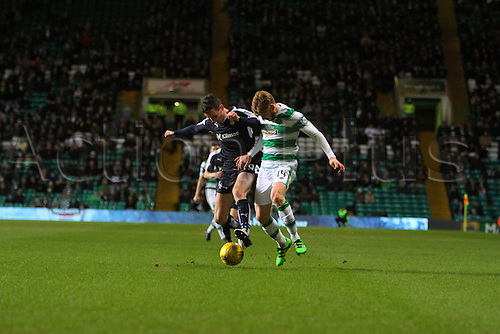 02.03.2016. Celtic Park, Glasgow, Scotland. Scottish Premier League. Celtic versus Dundee. Stuart Armstrong battles with  Paul McGinn
