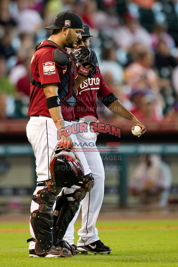 Houston Astros pitcher Wesley Wright #53 talks with catcher Carlos Corporan #22 during the Major League baseball game against the Philadelphia Phillies on September 16th, 2012 at Minute Maid Park in Houston, Texas. The Astros defeated the Phillies 7-6. (Andrew Woolley/Four Seam Images).