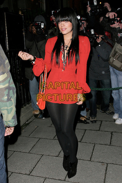 LILY ALLEN.The Finch & Partners' Chanel Pre-BAFTA Party held at Annabel's, London, England..February 7th, 2009.full length black dress tights red bag purse long sleeves ankle boots .CAP/AH.©Adam Houghton/Capital Pictures.