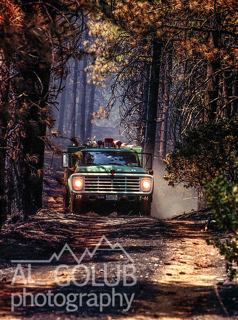 August 13, 1990 Yosemite National Park  --  A-Rock (Arch Rock) Fire  --  Fire truck moves toward Trumbull Peak during fire. The Arch Rock Fire burned over 16,000 acres of Yosemite National Park and the Stanislaus National Forest.  At the same time across the Merced River, the Steamboat Fire burned over 5,000 acres of both Yosemite National Park and the Sierra National Forest.
