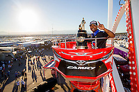 Nov 1, 2015; Las Vegas, NV, USA; NHRA top fuel driver Antron Brown poses for a photo with the championship trophy in the Toyota ferris wheel on the midway in the pits after clinching the 2015 top fuel dragster world championship during eliminations for the Toyota Nationals at The Strip at Las Vegas Motor Speedway. Mandatory Credit: Mark J. Rebilas-USA TODAY Sports