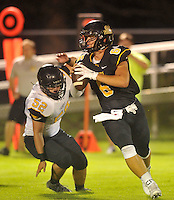 NWA Democrat-Gazette/MICHAEL WOODS &bull; @NWAMICHAELW<br /> Prairie Grove defender Dakota Hutchison (52) puts the pressure quarterback Sam Dodd (6) Thursday August 20, 2015 during the team scrimmage in Prairie Grove.