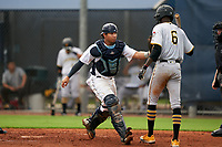 GCL Rays catcher Julio Meza (16) tags Deion Walker (6) during a Gulf Coast League game against the GCL Pirates on August 7, 2019 at Charlotte Sports Park in Port Charlotte, Florida.  GCL Rays defeated the GCL Pirates 4-1 in the first game of a doubleheader.  (Mike Janes/Four Seam Images)