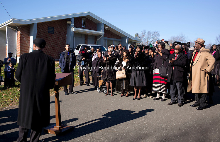 Waterbury, CT- 06 December 2015-120615CM02-Members of the community gather outside Mount Olive Church of God and Christ in Waterbury on Sunday.  A celebration was held unveiling a new street name for the late, bishop Tony Clemon, who started the church.  Berkley Ave. will also be known as  Bishop Tony Clemon Ave.  Christopher Massa Republican-American
