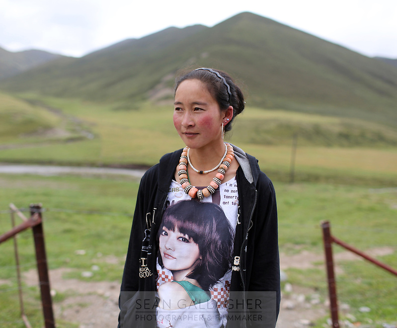 A young Tibetan woman in the Kham region of the Tibetan Plateau. Up to 100,000 nomads have been removed from the highland grasslands of the Tibetan Plateau. Climate change, mining and government policy are causing the rapid disappearance of this unique culture.