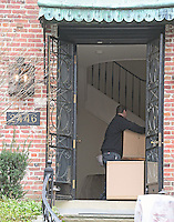 Movers carry boxes into the home at 2446 Belmont Road, NW; Washington, DC in the Kalorama neighborhood of Northwest Washington where where United States President Barack Obama and his family will reside after he leaves office. Photo Credit: Ron Sachs/CNP/AdMedia