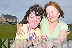 The only Kerry member on the Physically Challenged Irish and American Youth Team, Antoinette O'Sullivan (17), from Ballybunion who has the rare condition Apert Syndrome, who won nine medals in New York on May 27th. She is pictured at home in Doon Road with her mother Peig.   Copyright Kerry's Eye 2008