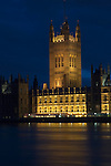 Houses of Parliament Victoria Tower floodlit at night, Westminster, London UK