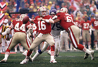 San Francisco 49er quarterback Joe Montana fires against the Vikings. #44 Tom Rathman and #61<br />
