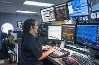 NWA Democrat-Gazette/BEN GOFF @NWABENGOFF<br /> Heydi Figueroa, Springdale dispatcher, works Thursday, Sept. 6, 2018, in the dispatch room at the Springdale Police Department.