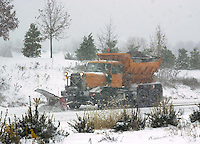 A snow plow clears a road of snow, Thursday, December 5, 2002 in Doylestown, Pennsylvania. The Philadelphia region was expecting 4-6 inches of snow from it's first major winter storm in two years. (Photo by William Thomas Cain/photodx.com)