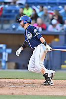 Asheville Tourists designated hitter Brian Mundell (15) swings at a pitch during a game against the Rome Braves at McCormick Field on April 16, 2016 in Asheville, North Carolina. The Braves defeated the Tourists 9-8. (Tony Farlow/Four Seam Images)