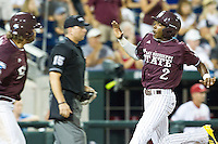 Mississippi State outfielder Demarcus Henderson (2) scores the game tying run in the eighth inning against the Indiana Hoosiers during Game 6 of the 2013 Men's College World Series on June 17, 2013 at TD Ameritrade Park in Omaha, Nebraska. The Bulldogs defeated Hoosiers 5-4. (Andrew Woolley/Four Seam Images)
