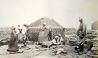 BNPS.co.uk (01202 558833)<br /> Pic: ClevedonAuctionRooms/BNPS<br /> <br /> Mongolian family setting up a traditional nomadic Yurt.<br /> <br /> Rev Francis John Griffith travelled as a Missionary aroud Outer Mongolia in the 1920's.<br /> <br /> A fascinating collection of early 20th century photos of Mongolia and China which were taken by a British vicar doing missionary work have been unearthed after 97 years.<br /> <br /> Through his famine relief work Reverend Francis John Griffith was able to get a remarkable insight into the lives of the native population and their nomadic existence.<br /> <br /> His encounters were captured using a handheld camera that he carried with him at all times.<br /> <br /> In one image a family goes about its business outside the hut that is their home, while another image is of a man riding a camel which was the typical method of transport.<br /> <br /> Revd Griffith was able to get native elders to sit for him in portraits and there are intimate snaps of women and children wearing elaborate native headdresses.<br /> <br /> As well as the people, Revd Griffith took an interest in the surroundings and photographed temples and prominent buildings in addition to the vast, desert landscape.