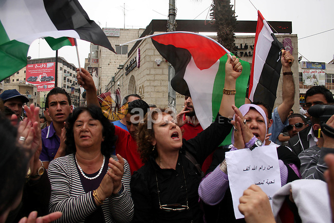 Palestinians celebrate during a rally in the West Bank city of Ramallah on May 04, 2011 as Palestinians in the West Bank and Gaza Strip gather to welcome a reconciliation deal signed by rival movements Hamas and Fatah in Cairo. Photo by Issam Rimawi