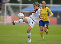 Heather O´Reilly (9) kicks the ball in front of Sweden's Therese Sjögran (15) during the match against Sweden, Landskamp, Sweden, July 5th, 2008.