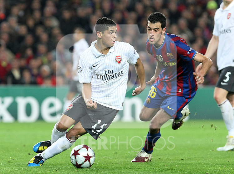 Arsenal's Denilson (l) and FC Barcelona's Sergio Busquets  during UEFA Champions League match. April 6, 2010. (ALTERPHOTOS/Acero)