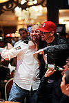 "Daniel Negreanu is hugged by Donnie Wahlburg after he took all of Negreanu's chips. Negreanu had to ""rebuy."""