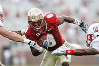 TALLAHASSEE, FL 10/31/09-FSU-NCST FB09 CH20-Florida State's Taiwan Easterling is sandwiched by N.C. State's Audie Cole, left, and DeAndre Morgan during first half action Saturday at Doak Campbell Stadium in Tallahassee. .COLIN HACKLEY PHOTO