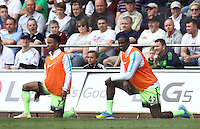 Raheem Sterling and Yaya Toure of Manchester City warm up during the Barclays Premier League match between Swansea City and Manchester City played at The Liberty Stadium, Swansea on 15th May 2016