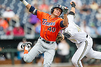 Cal State Fullerton outfielder Josh Vargas (40) attempts to avoid being tagged at first base during the NCAA College baseball World Series against the Vanderbilt Commodores Titans on June 15, 2015 at TD Ameritrade Park in Omaha, Nebraska. Vanderbilt beat Cal State Fullerton 4-3. (Andrew Woolley/Four Seam Images)