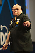 20.12.2014.  London, England.  William Hill World Darts Championship.  Andy Smith (28) [ENG] celebrates a 180 score during his match with Ronny Huybrechts [BEL]. Huybrechts won the match 3-0.