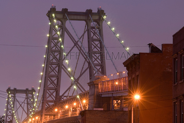 AVAILABLE FROM JEFF AS A FINE ART PRINT.<br /> <br /> AVAILABLE DIRECTLY FROM JEFF FOR COMMERCIAL/EDITORIAL LICENSING<br /> <br /> The Williamsburg Bridge seen from the Williamsburg neighborhood of Brooklyn, illuminated at Dusk, Brooklyn, New York City, New York State, USA