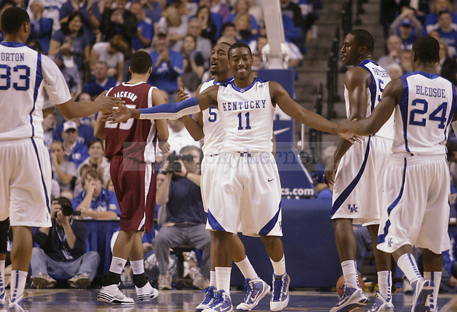 University of Kentucky freshman guard John Wall hi-fives teammates after drawing a foul during the first half of UK's 92-63 win over Rider on Nov. 21, 2009 in Lexington, Ky...Ed Matthews | Staff