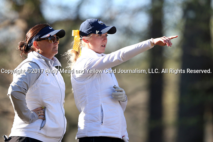 BROWNS SUMMIT, NC - APRIL 01: UNCG's Alexis Kershaw (right) consults with head coach Janell Howland (left) on the 11th hole. The first round of the Bryan National Collegiate Women's Golf Tournament was held on April 1, 2017, at the Bryan Park Champions Course in Browns Summit, NC.