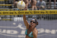 Huntington Beach, CA - 5/5/07:   Misty May-Treanor spikes the ball during May-Treanor / Walsh's 21-14, 21-12 victory over McPeak / Tom Saturday during the 2007 AVP CROCS Tour in Huntington Beach..Photo by Carlos Delgado
