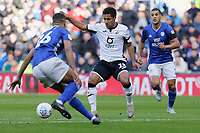 Wayne Routledge of Swansea City (C) gets past Curtis Nelson of Cardiff City (L) during the Sky Bet Championship match between Cardiff City and Swansea City at the Cardiff City Stadium, Cardiff, Wales, UK. Sunday 12 January 2020