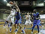 SIOUX FALLS, SD - NOVEMBER 30:  Deondre Parks #0 from South Dakota State University eyes the basket past Eric Moeller #42 from Florida Gulf Coast in the second half of their game Sunday afternoon at the Sanford Pentagon in Sioux Falls. (Photo by Dave Eggen/inertia)