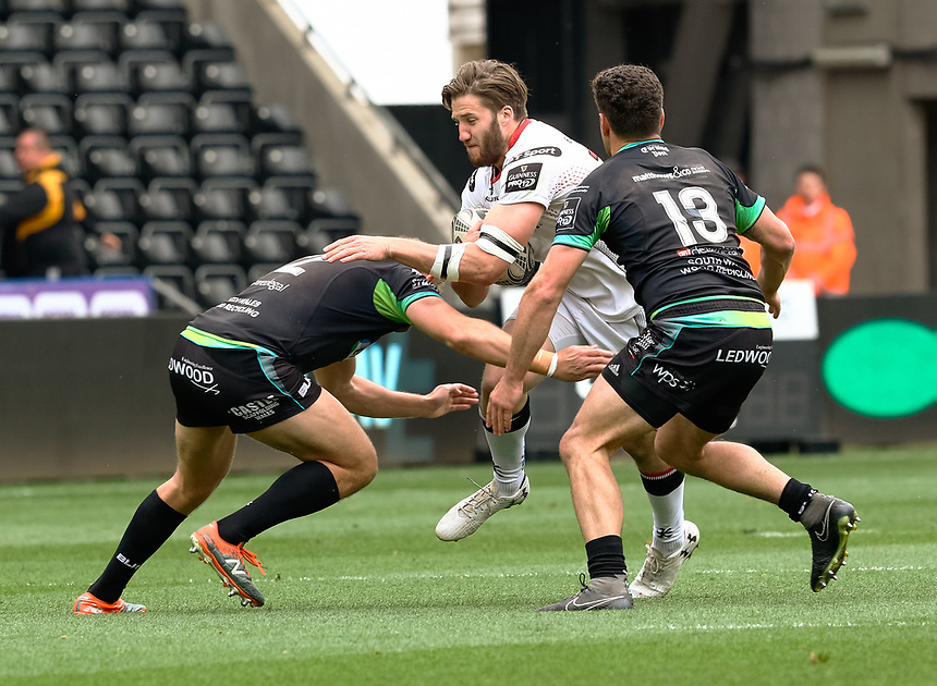 Ulster's Stuart McCloskey under pressure from Ospreys' Scott Baldwin<br /> <br /> Photographer Simon King/CameraSport<br /> <br /> Guinness Pro12 Round 21 - Ospreys v Ulster Rugby - Saturday 29th April 2017 - Liberty Stadium - Swansea<br /> <br /> World Copyright &copy; 2017 CameraSport. All rights reserved. 43 Linden Ave. Countesthorpe. Leicester. England. LE8 5PG - Tel: +44 (0) 116 277 4147 - admin@camerasport.com - www.camerasport.com