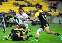 James Marshall and Matt Proctor close down Seta Tamanivalu during the Super Rugby semifinal match between the Hurricanes and Chiefs at Westpac Stadium, Wellington, New Zealand on Saturday, 30 July 2016. Photo: Dave Lintott / lintottphoto.co.nz
