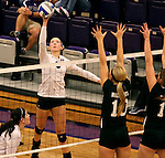SIOUX FALLS, SD - SEPTEMBER 23: Emily Johnson #8 from University of Sioux Falls tips the ball past Alyssa Frauendorfer #10 and Alex Opperman #16 from Wayne State Tuesday night at the Stewart Center.  (Photo by Dave Eggen/Inertia)