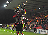 Lincoln City's Matt Green, right, celebrates scoring his side's second goal with team-mate Bernard Mensah<br /> <br /> Photographer Andrew Vaughan/CameraSport<br /> <br /> The EFL Checkatrade Trophy Northern Group H - Lincoln City v Wolverhampton Wanderers U21 - Tuesday 6th November 2018 - Sincil Bank - Lincoln<br />  <br /> World Copyright © 2018 CameraSport. All rights reserved. 43 Linden Ave. Countesthorpe. Leicester. England. LE8 5PG - Tel: +44 (0) 116 277 4147 - admin@camerasport.com - www.camerasport.com