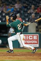 Connor Scott (23) of the Greensboro Grasshoppers follows through on his swing against the West Virginia Power at First National Bank Field on August 9, 2018 in Greensboro, North Carolina. The Power defeated the Grasshoppers 9-7 in game two of a double-header. (Brian Westerholt/Four Seam Images)