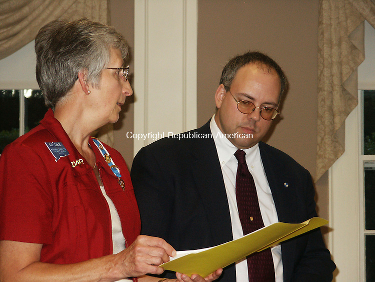 WATERTOWN, CT - 13 SEPTEMBER 2007 -092607TV01 -- Katie Gabrielson, left, chairwoman of the Trumbull-Porter Chapter of the Daughters of the American Revolution awards committee, reads testimonial remarks to Jeff Grenier, president of the Watertown Historical Society, at the Sept. 13 DAR meeting that honored Grenier with its communty service award. Tommy Valuckas Republican American