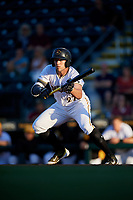 Bradenton Marauders center fielder Casey Hughston (27) squares around to bunt during a game against the Tampa Tarpons on April 25, 2018 at LECOM Park in Bradenton, Florida.  Tampa defeated Bradenton 7-3.  (Mike Janes/Four Seam Images)