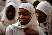 Zanzibar, Tanzania. Muslim school girls with white headscarves.