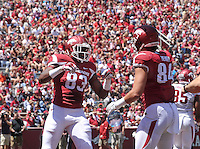 NWA Democrat-Gazette/Michael Woods --04/25/2015--w@NWAMICHAELW... University of Arkansas tight end Jeremy Sprinkle celebrates with teammate Hunter Henry after scoreing a touchdown during the 2015 Red-White game Saturday afternoon at Razorback Stadium in Fayetteville.