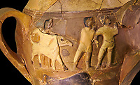 Hüseyindede vases, Old Hittite Polychrome Relief vessel, close up depicting a bull being led to be sacrificed, following Hittite convention of sacrificing an animal of the same gender as the God this bull indicates the sacrifice is to a male god, 16th century BC.. Çorum Archaeological Museum, Corum, Turkey. Against a black bacground.