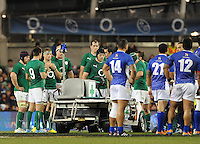 9th November 2013; Ireland and Samoa players watch on as Brando Vaaulu of Samoa receives treatment for an injury. Autumn International Series, Ireland v Samoa, Aviva Stadium, Dublin. Picture credit: Tommy Grealy/actionshots.ie.