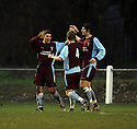 Dan Holman of Long Buckby (l) celebrates scoring the third goal with team-mates during the FA Carlsberg Vase 3rd round  match between Stotfold and Long Buckby at Roker Park, Stotfold on 4th December, 2010.© Kevin Coleman 2010.
