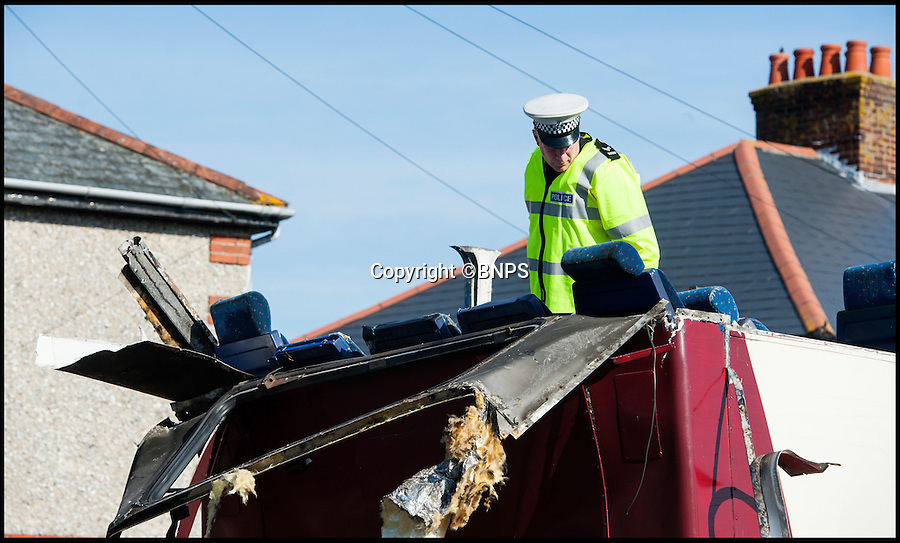 BNPS.co.uk (01202 558833)<br /> Pic: TomWren/BNPS<br /> <br /> A police office assess the damage.<br /> <br /> Students had a miraculous escape today after the roof of a double decker bus sheared off when it ploughed into a railway bridge next to a primary school.<br /> <br /> Teenagers on the top deck ducked at the moment the vehicle crashed, ripping off the headrests of their seats and slicing off the roof.<br /> <br /> The dramatic collision occurred just as hundreds of young children arrived at the primary school in Bournemouth with many lucky not to have been hit by the roof as it fell onto the road or by debris.