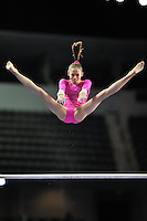 02/20/09 - Photo by John Cheng for USA Gymnastics.  US gymnast Bridgette Caquatto performs on uneven bars in a meet against Japan before the Tyson American Cup at Sears Centre Arena in Chicago.