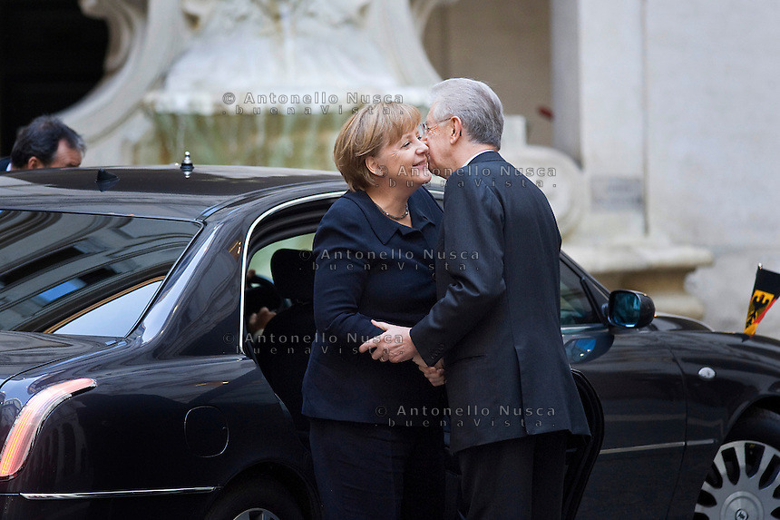 Mario Monti riceve la Cancelliera tedesca Angela Merkel a Palazzo Chigi. .Italian Prime Minister Mario Monti  waiting to meet with German Chancellor Angela Merkel at Palazzo Chigi in Rome.