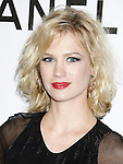 January Jones arrives at Chanel's Launch of Highly Anticipated New Concept Boutique on Robertson Boulevard on May 29, 2008 in Los Angeles, California.